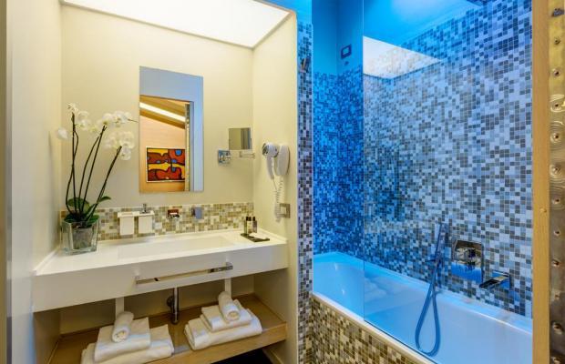 фото Dharma Hotel & Luxury Suites изображение №10